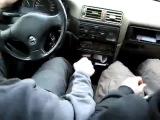 Отец учит сына водить автомобиль.